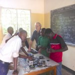 Joe Scholtz teaching students at Makomu Secondary School