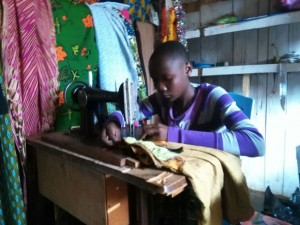 Delivina at her sewing machine